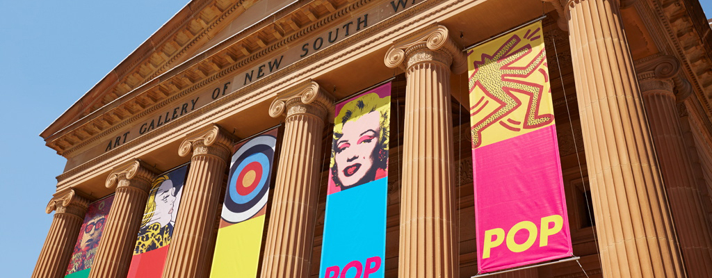 Banners hang from the Art Gallery of New South Wales featuring artworks licensed by Viscopy.